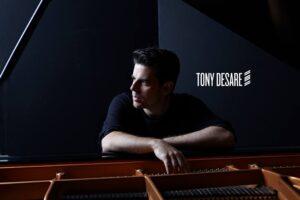 Tony sitting at a piano.